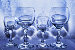 Four glasses in a shop window. With blue reflections Royalty Free Stock Photo