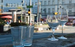 Four glasses are standing at the roadside after a party stock photo