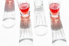 Glasses with juice and their shadow royalty free stock photography