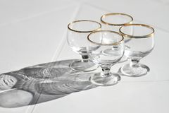 Four glasses on the table Stock Photos