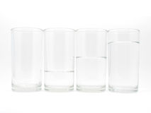 Four glasses with three level of water Royalty Free Stock Image