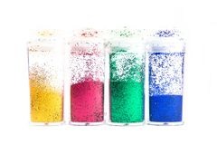 Four glitter bottles Royalty Free Stock Photos