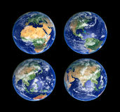 Four Globes. Four Earth Globes with clouds, high res pictures Stock Photography