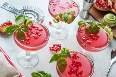 Pomegranate Basil Martini Cocktails with Ingredients on Bar Royalty Free Stock Image
