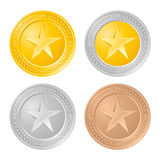 Four gold coins Stock Image