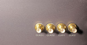 Four gold connectors. In a room mobile networks stock photo