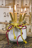 Four golden candles, traditional christmas decoration Stock Images