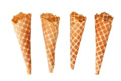 Four golden crispy ice cream waffle cones on white background isolated closeup top view stock photos