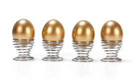 Four golden eggs in a row Royalty Free Stock Images