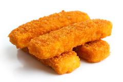 Four golden fried fish fingers stacked on white Royalty Free Stock Photo