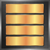 Golden plates. Four golden plates on black background Stock Photography