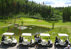 Four golf carts infront of fountain Royalty Free Stock Image