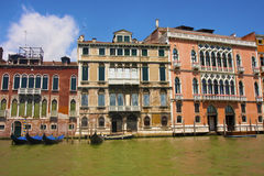 Four Gondolas by Buildings in Venice Stock Photo