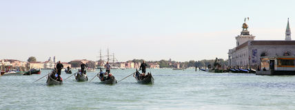 Four gondoliers Stock Images