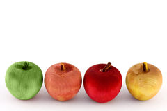 Four good apples. Four small wooden apples in a row to create a border Royalty Free Stock Photos
