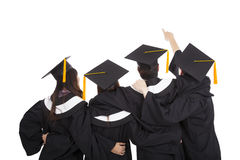 Graduate students pointing and looking up royalty free stock photography
