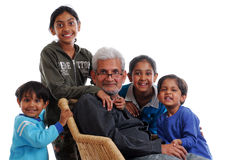 Four grand children with grand father. Happy grand children with grand father royalty free stock images