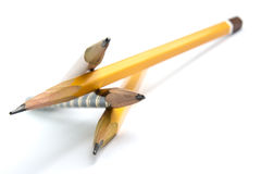 Four gray pencil. Close-up on white background Stock Photo