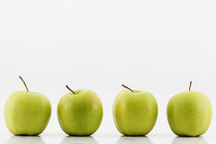 Four green apples. On white background stock images