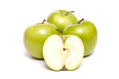 Four green apples royalty free stock photography