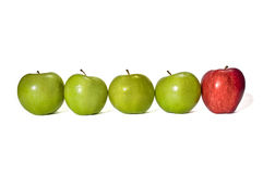 Four Green Apples With One Red Apple Royalty Free Stock Image