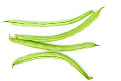 Four green bean pods stock images