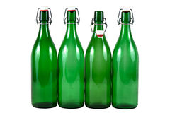 Four green bottles Stock Image