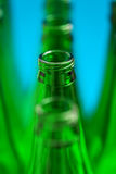 Four green bottles in one row. Royalty Free Stock Photo