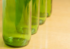 Four green bottles Royalty Free Stock Images