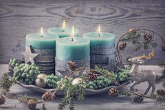 Four green christmas candle Stock Photos