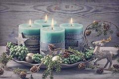 Four green christmas candle Stock Photos