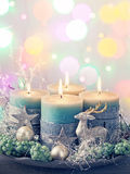 Four green christmas candle Stock Images