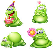 Four green monsters with different activities Royalty Free Stock Images