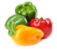 four green, red, yellow sweet bell peppers isolated on white background Stock Photo
