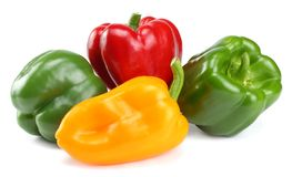 four green, red, yellow sweet bell peppers isolated on white background Royalty Free Stock Photos