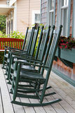 Four green rocking chairs Stock Image
