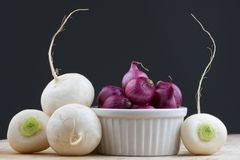 Four green tupnips with red pearl onions Royalty Free Stock Photo