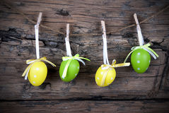 Four Green And Yellow Easter Eggs With Frame Stock Photos