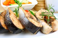 Four Grilled salmon steak with vegetables Royalty Free Stock Photo