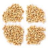 Four groups of roasted cashews Royalty Free Stock Photos