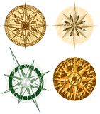 Four Grunge Compasses Royalty Free Stock Photos