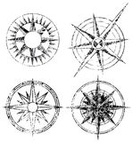 Four Grunge Compasses Stock Photo