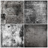 Four grunge textures. Four grunge textured backgrounds in monochrome on four equal tiles royalty free stock photos