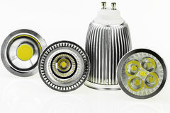 Four GU10 LED bulbs with various sizes of chips and cooling Royalty Free Stock Photography