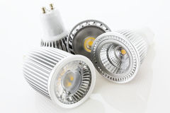 Four GU10 LED lamps with different designs of the cooling Royalty Free Stock Images