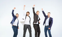 Four guys making a victory gesture Stock Photos