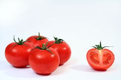 Four and half tomatoes. Four and a half tomatoes isolated on a white background. Red and white predominant colors Stock Photography
