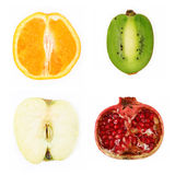 Four halved fruit Stock Images