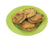 Whole wheat English muffins on plate Stock Photo