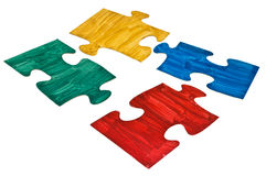 Four hand painted jigsaw puzzle pieces Stock Image